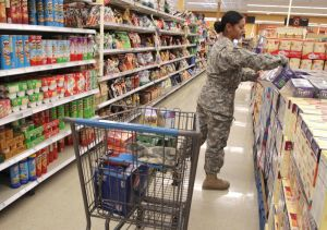 Commissary Opens: Private Gladis Felix shops for groceries at the Warrior Way commissary at Fort Hood, after most of the civilian workers who were furloughed as a result of the government shutdown returned to work Monday, Oct. 7, 2013. - Photo by Herald/Jaime Villanueva