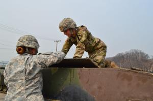 <p>Pfc. Evelyn Gomez, left, and Pfc. Kelley McKeon, are both mechanics with 2nd Battalion, 12th Cavalry Regiment, 1st Brigade Combat Team, 1st Cavalry Division. The are shown working March 29, 2016, at the 2-12 CAV motor pool at Camp Casey, South Korea.</p>