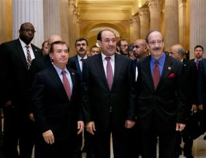 Iraq Seeks New U.S. Aid: Iraq's Prime Minister Nouri al-Maliki, center, walks with Rep. Eliot Engel, D-N.Y., right, and Rep. Ed Royce, R-Calif., on Capitol Hill in Washington, Wednesday, Oct. 30, 2013, before their meeting. Earlier, the prime minister met with Vice President Joe Biden. - Molly Riley | AP