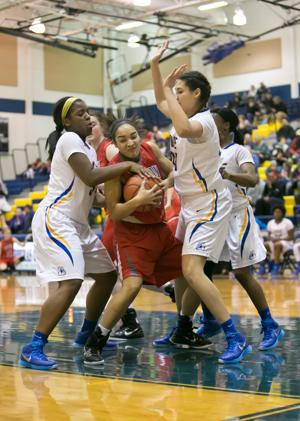<p>Belton's Blair Gilbert, middle, battles for possession with Copperas Cove's Chyanne Chapman, left, and Kenya Haynes Friday in Copperas Cove.</p>