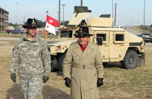 <p>Lt. Col. John P. Cogbill, commander of the 2nd Squadron, 38th Cavalry Regiment, 504th Battlefield Surveillance Brigade, speaks with retired Lt. Col. Alfred Shehab on Thursday morning at Fort Hood.</p>