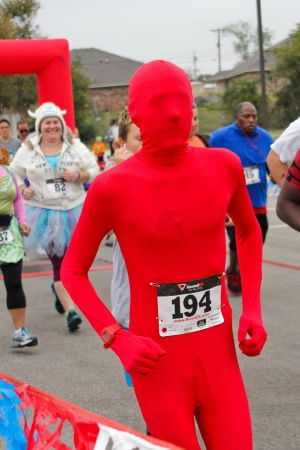 Monster Dash: A runner dressed in a costume of red from head to toe takes off from the starting line during the Monster Dash 5K on Saturday morning. The event was held to raise funds for polio research. - Photo by Jodi Perry | Herald