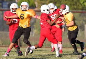 Future Stars Football: Eigth-grade students from Smith Middle School and Manor Middle School compete in a game Tuesday at Manor. - Herald/CATRINA RAWSON
