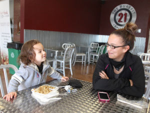 Living Here - Healthy Living: Tiffany Collinge has a meal with her son Elijah, 2, Thursday, November 14, 2013 at Purefit Foods in Killeen. - Herald/CATRINA RAWSON