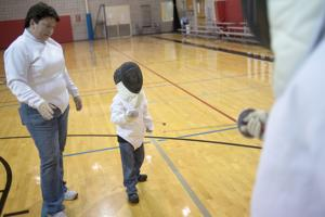 Fencing instructor Jo Tye teaches students the art of the sword