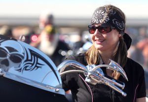 18th Annual Bell County Toy Run: Erica McPhail, of Copperas Cove, gear, up to participate in the 18th annual Bell County Toy Run on Sunday, Nov. 17, 2013, at Fort Hood Harley-Davidson in Harker Heights. - Photo by Herald/CATRINA RAWSON