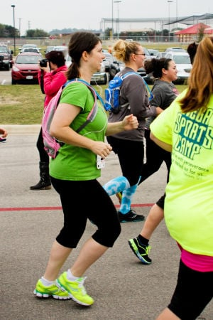 Monster Dash: Danielle Smith of Killeen participated in her first 5K on Saturday morning at the Monster Dash, which was held at Harker Heights Community Park to raise money for polio research. - Jodi Perry | Herald
