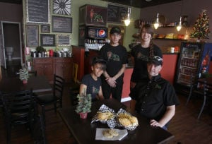 <p>From left, front row, Widaly Rodriguez and owner Gabor Kristof and, back row, Ala Abdelhadi and Lindsay Foster pose Thursday afternoon at the Gyro Nook in Killeen.</p>