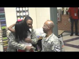 Father-and-son Fort Hood soldiers surprise family members at school.
