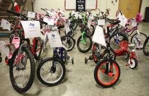 Bike Giveaway: More than 30 bikes sit in the lobby during the giveaway event hosted by the New Light Masonic Lodge No. 242 on Thursday, Dec. 19, 2013, at the National Guard Armory in Killeen. - Herald/MARIANNE GISH
