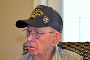 "WWII Vets- Bob Copeland Cap.jpg: Bob Copeland, 87, entered into World War Two at age 15. ""It was so different back then. We had no basic training. You just showed up, got your uniform and were sent off to war."" Bryan Correira - Photo by Picasa"