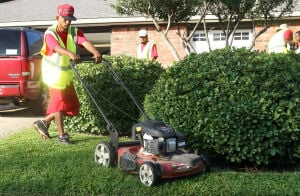 Landscaping Business: Billy D. Rorie, with Central Texas Home and Lawn Transitions, mows a yard Thursday morning on Stillwood Drive in Killeen. - Herald/MARIANNE LIJEWSKI