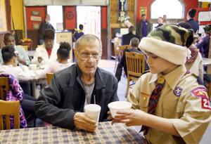 Cub Scouts serve vets local barbecue