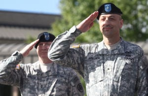 OTC Promotion Ceremony: Newly promoted Brig. Gen. Scott A. Spellmon, commander of the Operational Test Command, right, and Maj. Gen. Bryan G. Watson, left, salute during his promotion ceremony Friday morning outside the Operation Test Command building on West Fort Hood. - Herald/MARIANNE LIJEWSKI