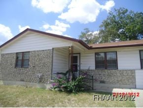 Nice older home on corner lot. Covered patio fenced yard.