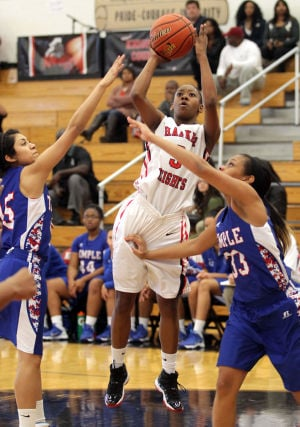 <p>Harker Heights' Alexus Dukes shoots against Temple on Friday afternoon at Harker Heights High School.</p>