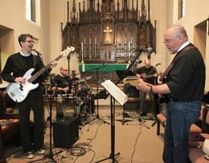 <p>Members of the band Monstrance rehearse Feb. 21 at St. Matthias Episcopal Church in Waukesha, Wis. The band features the Rev. Drew Bunting, front left, the Rev. David Simmons, rear left, the Rev. Don Fleischman, rear right, and the Rev. Andrew Jones, front right.</p>
