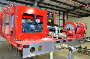 Fire Truck: A finished fire pump bed at Kryish Government Group's work bay awaits to be mated to an M 939. The tank can hold up to 1,500 pounds of water. - Bryan Correira | Herald