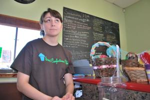 <p>Christina Elser gets ready to ring up a customer at her new Sweet Confections Cafe in Belton.</p>
