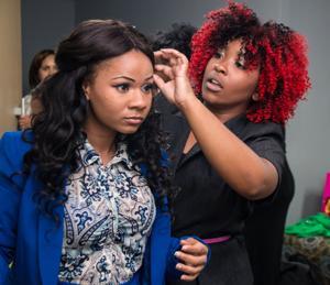 Contestant AshLyon Rozier helps Lauren Dye get dressed