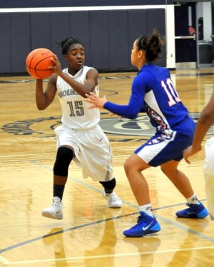 <p>Shoemaker's Daysha Roberts (15) is guarded by Temple's Jazzmen Ortiz on Tuesday.</p>