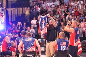 <p>Members of the U.S. wheelchair basketball team celebrate after winning Gold at the 2016 Invictus Games in Orlando, Fla. Retired Sgt. 1st Class Chuck Armstead, a Killeen resident, played on the team.</p>