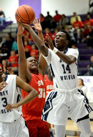 <p>Shoemaker's Javon Levi drives to the hoop in a Class 6A first-round playoff game Tuesday against South Grand Prairie at Waco University High School. Levi had 23 points and nine assists, and seventeenth-ranked Shoemaker won 75-57.</p>