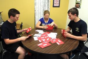 Students prepare holiday greetings for troops overseas