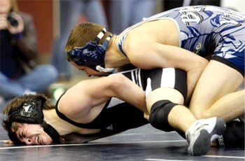 Bryan wins another district wrestling title, Ellison finishes in third place