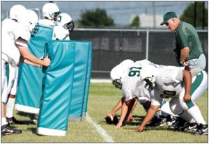 Area spring football practices heat up