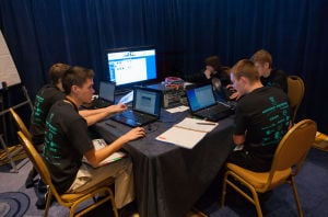 CYBER-CONTESTS: Saige Mehl, left, Brian Green, Kevin Schulmeister, Ben Wolff and Keaton Thomson of the Summit Technology Academy in Lee's Summit, Mo., take part in the CyberPatriot event at National Harbor, Md., in March. - Air Force Academy