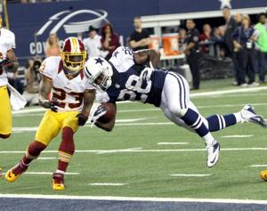 Cowboys fall to RG III, Redskins