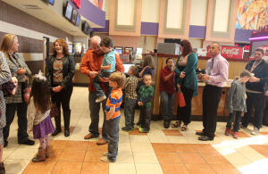 "Vintage Church: Church goers line up to attend the first service of the newly formed ""Vintage Church,"" Sunday, January 19, 2014 at Cinemark Theaters in Harker Heights. - Herald/CATRINA RAWSON"