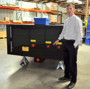 Fire Truck: Shane Hesselbacher, operations manager for the Kryish Government Group, explains the water pump bed that holds 1,500 pounds of water and can also use foam retardent on fires. - Bryan Correira | Herald