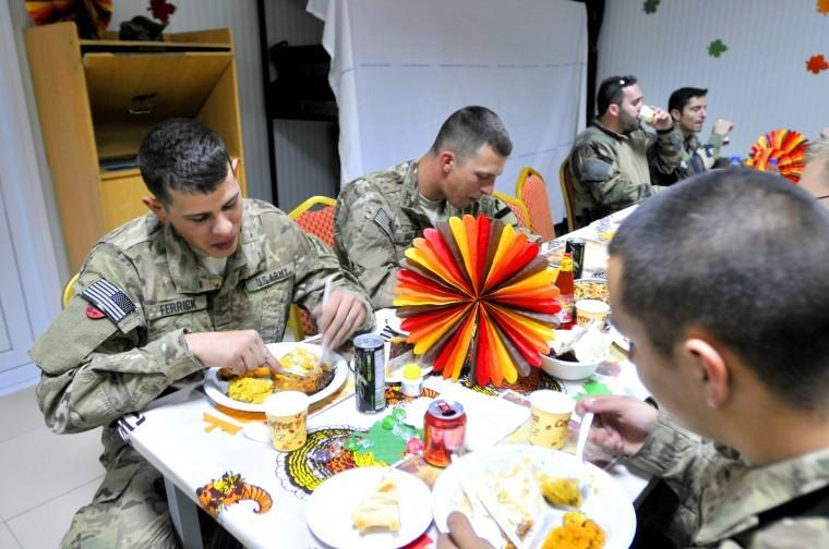Long Knife carves Thanksgiving turkey