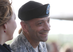 OTC Promotion Ceremony: Newly promoted Brig. Gen. Scott A. Spellmon, commander of the Operational Test Command, smiles as Maj. Gen. Bryan G. Watson, not pictured, gives a speech about Spellmon during his promotion ceremony Friday morning outside the Operation Test Command building on West Fort Hood. - Herald/MARIANNE LIJEWSKI