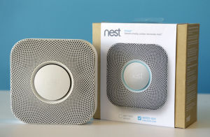 Feathering The Nest: The Nest smoke and carbon monoxide alarm is shown at the company's offices on Tuesday, Oct. 1, 2013, in Palo Alto, Calif. Tony Fadell, a gadget guru who helped design the iPod and original iPhone while working at Apple, is counting on his latest innovation to prove that a smoke detector can be sleek, smart and appreciated. - Marcio Jose Sanchez | AP