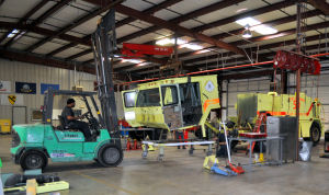Fire Truck: The cab of a Marine Corps Air Station Miramar P-19 Fire Crash Rescue truck is removed at Kryish Government Group's work bay in Killeen. - Bryan Correira | Herald