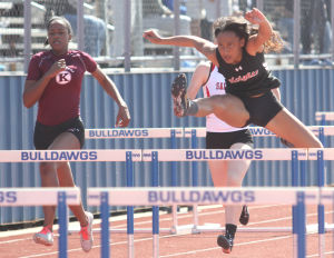 <p>Harker Heights' Jaleea Bonnell leads the pack in the girls 100-meter hurdles Saturday during the Bulldawg Relays at Bulldawg Stadium in Copperas Cove.</p>