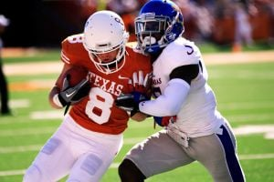 Kansas-Texas Football: Texas wide receiver Jaxon Shipley runs the ball against Kansas safety Isaiah Johnson on Saturday in Austin. Texas won 35-13.  - Photo by Sam Ortega | AP/The Daily Texan