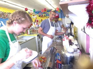 Ice Cream Parlor: Employee Jennifer Kloesel, left, owner John Hayes, middle, and manager Charley Hayes work behind the counter at the Waffle Cone. - Wendy Sledd | Copperas Cove Hera
