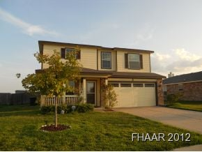 Well maintained and beautifully landscaped 2 story home with view.