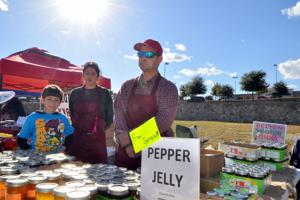 <p>Jeff Oaks stands with his wife, Amena and son Clayton, 10, with jellies made with peppers, from his Belton Veggie Guys company Tuesday, Nov. 25, 2014 at the Harker Heights Chamber of Commerce block party at Market Heights, located at 201 E. Central Texas Expressway, in Harker Heights.</p>