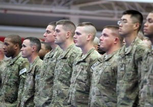 937th Route Clearance Company Homecoming: Soldiers from the 937th Route Clearance Company, 8th Engineer Battalion, 36th Engineer Brigade, stand in formation before a homecoming ceremony Monday, Nov. 4, 2013, at the West Fort Hood Physical Fitness Center. - Herald/CATRINA RAWSON