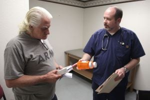 Cove Free Clinic: Nurse Don Webb, right, talks to Lou Fercazza during the opening day of the Cove House new clinic Tuesday in Copperas Cove. - Jaime Villanueva