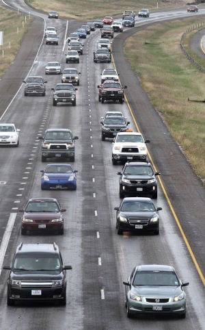 U.S. Highway 190: Vehicles head east on U.S. Highway 190 during lunch hour Wednesday in Killeen. Local groups are trying to get part of U.S. Highway 190 designated an interstate highway in addition to its current designation. - Herald/MARIANNE LIJEWSKI