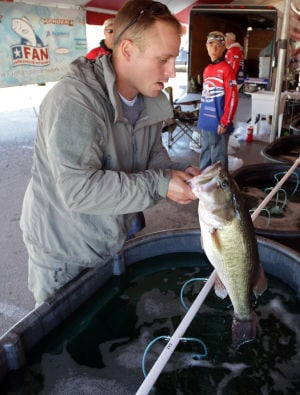 Fishing For Freedom: Dustin Roberts holds a large mouth bass after winning the eighth annual Fishing for Freedom tournament Saturday, Oct. 19, 2013, at Belton Lake Outdoor Recreation Area. - Jaime Villanueva | Herald