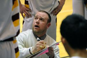 <p>Lometa coach Aaron Nuckles diagrams a play during a timeout Friday night in Corsicana. The Hornets suffered a 55-45 loss to Mount Enterprise.</p>