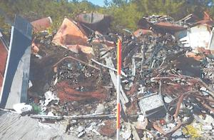 <p>This image from a Texas Commission on Environmental Quality inspector's report shows a pile of debris on the property of KAI Dairy of Lampasas as seen during an October visit.</p>