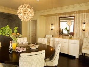 DESIGN-DINING-QANDA: A formal dining room created by designer Tricia Huntley in 2006 incorporates sconces and a chandelier; her self-described